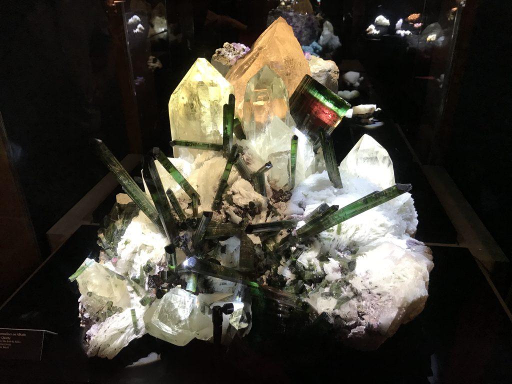 Elbaite and albaite tourmaline on smoky quartz.